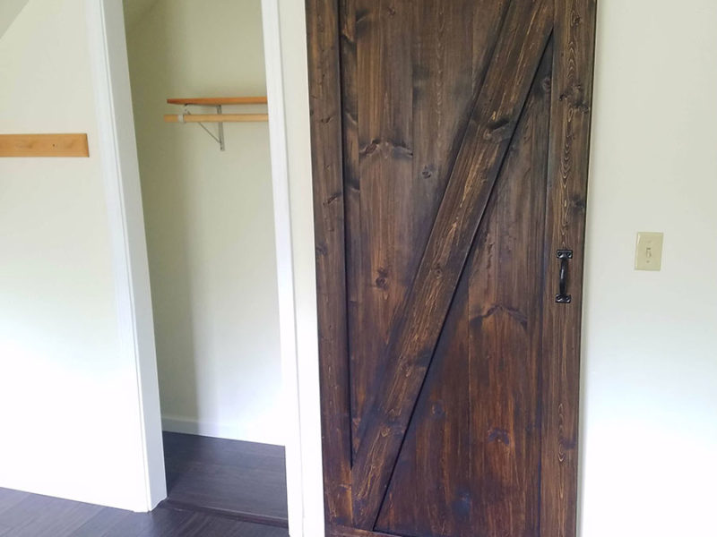 Grayling Cabin - Barn door style closet